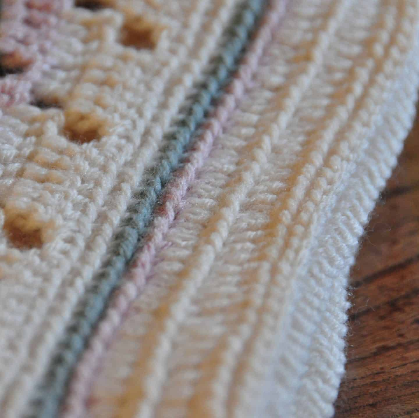 Learn to crochet this soft and subtle baby blanket as the perfect gift for a new arrival. Including a free crochet pattern and stitch tutorial anyone, even beginners, can master this filet crochet technique.
