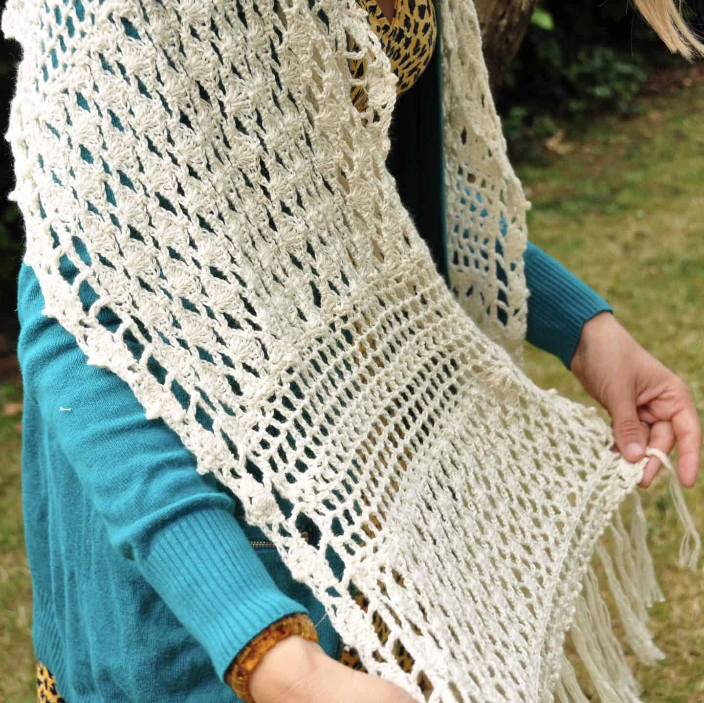 Learn to crochet this exquisite lace crochet shawl with a free crochet pattern and step by step crochet lace shell stitch tutorial. The rectangular shawl in made from 5 shell stitch panels joined by filet crochet sections and completed with a simple and delicate fringe. A beautiful wedding, confirmation or baptism shawl.