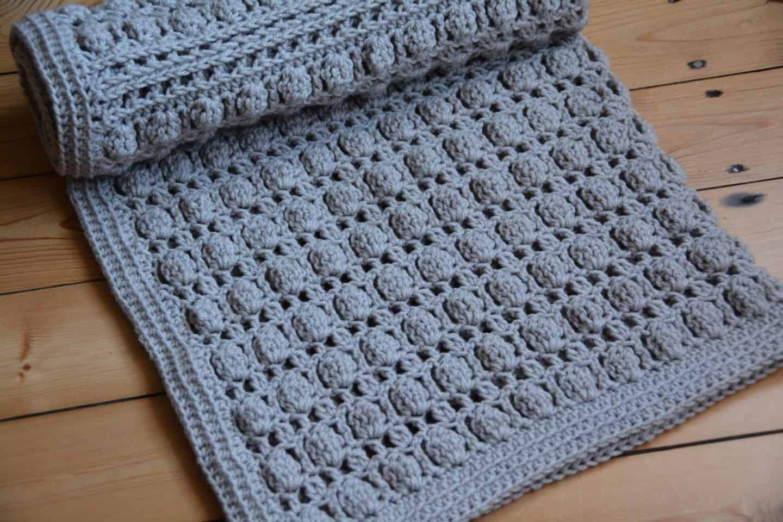 Oyster Shell Blanket free crochet pattern by Hannah Cross. Learn to crochet the cluster stitch, free baby crochet blanket pattern. Easy crochet blanket pattern.