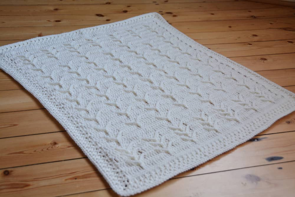 Cleo's Cloud Blanket a free crochet blanket pattern by Hannah Cross HanJan Crochet. Learn to crochet an heirloom baby blanket. Cream plain baby crochet blanket.