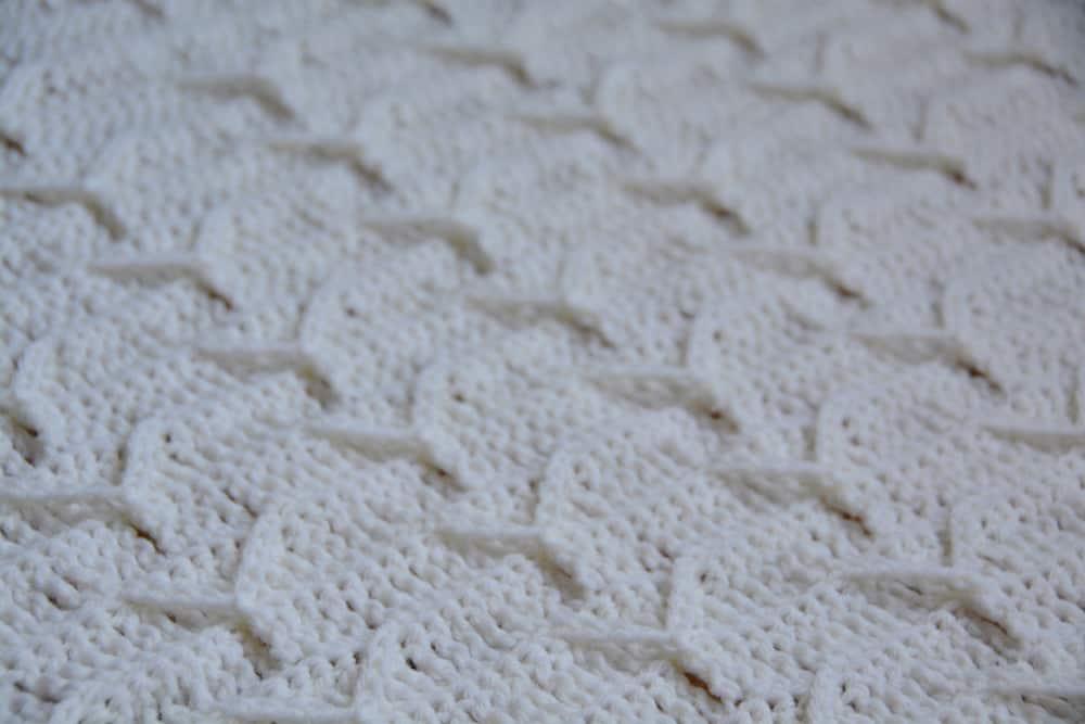 Cleo's Cloud Blanket a free crochet blanket pattern by Hannah Cross HanJan Crochet. Learn to crochet an heirloom baby blanket. Cream plain baby crochet blanket.