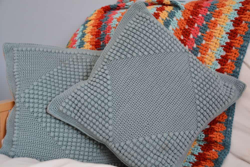 Free crochet pattern crochet bobble diamond cushions. Homeware, handmade home, handmade pillow, learn to crochet bobble stitch.