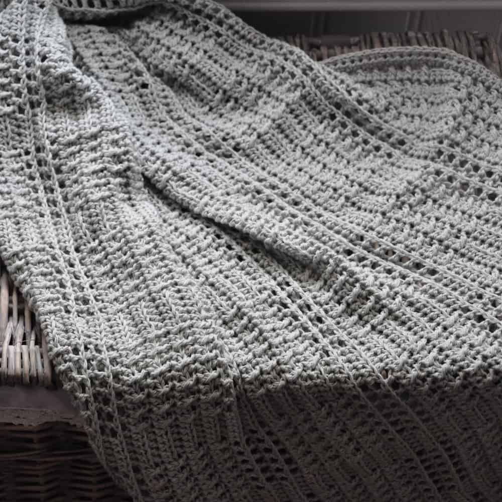 The Silver Squares Crochet Baby Blanket, a free beginners crochet pattern by HanJan Crochet, Hannah Cross. Learn to crochet this classic and easy baby blanket.