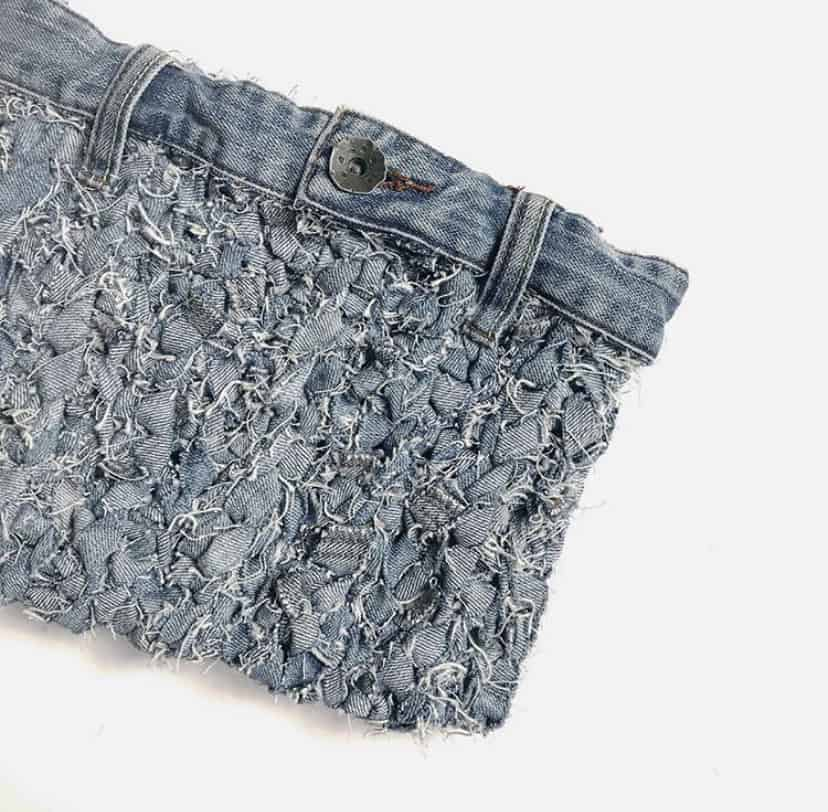 How to make jeans yarn and then crochet it into a fabulous denim clutch bag. A free how to tutorial and crochet pattern from HanJan Crochet.