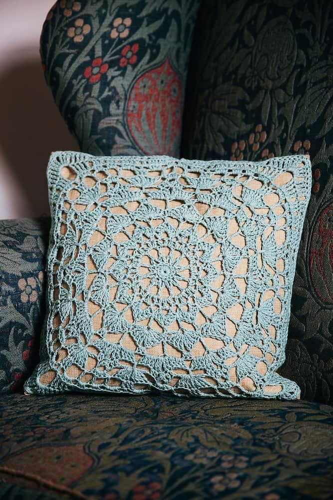 Simple lace crochet cushion William Morris chair. Free crochet home decor pattern.