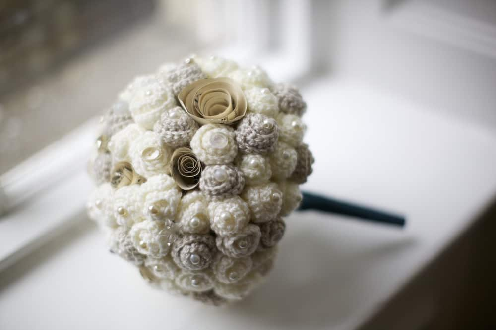 The most sophisticated handmade crochet wedding bouquet. Cream and ivory flowers with pearly bead and vintage buttons and brooches.