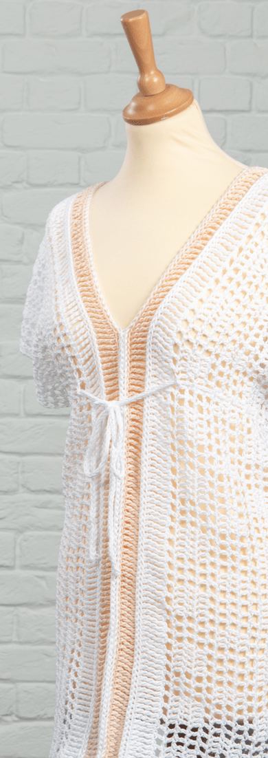 Learn to crochet the effortless Peachy Bikini Cover Up Top with this easy free crochet pattern. The super simple construction consists of just two long panels of filet crochet, slip stitch detailing and long triple treble crochet stitches which make a really pretty, delicate fabric that is so easy to both make and wear. Perfect for days by the pool, lazy days in the garden with shorts or to dress up with heels for a night out.