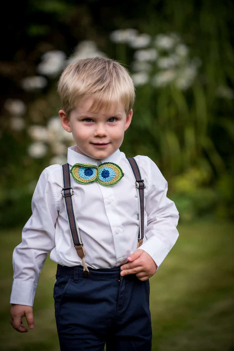Crochet wedding bow tie for little boys. In peacock feather colours.