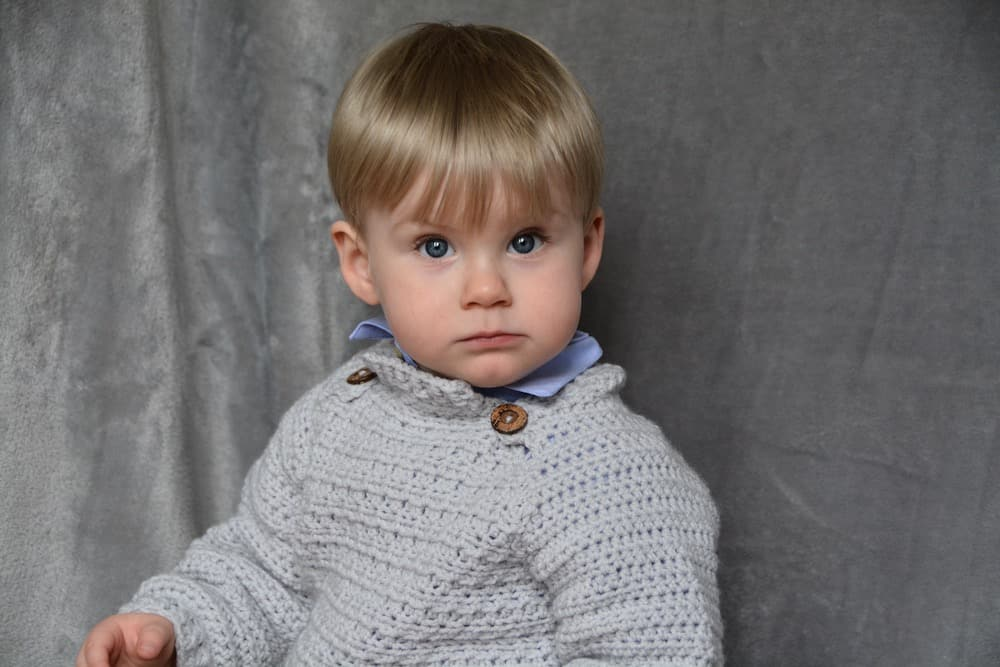 little boy in grey crochet baby jumper