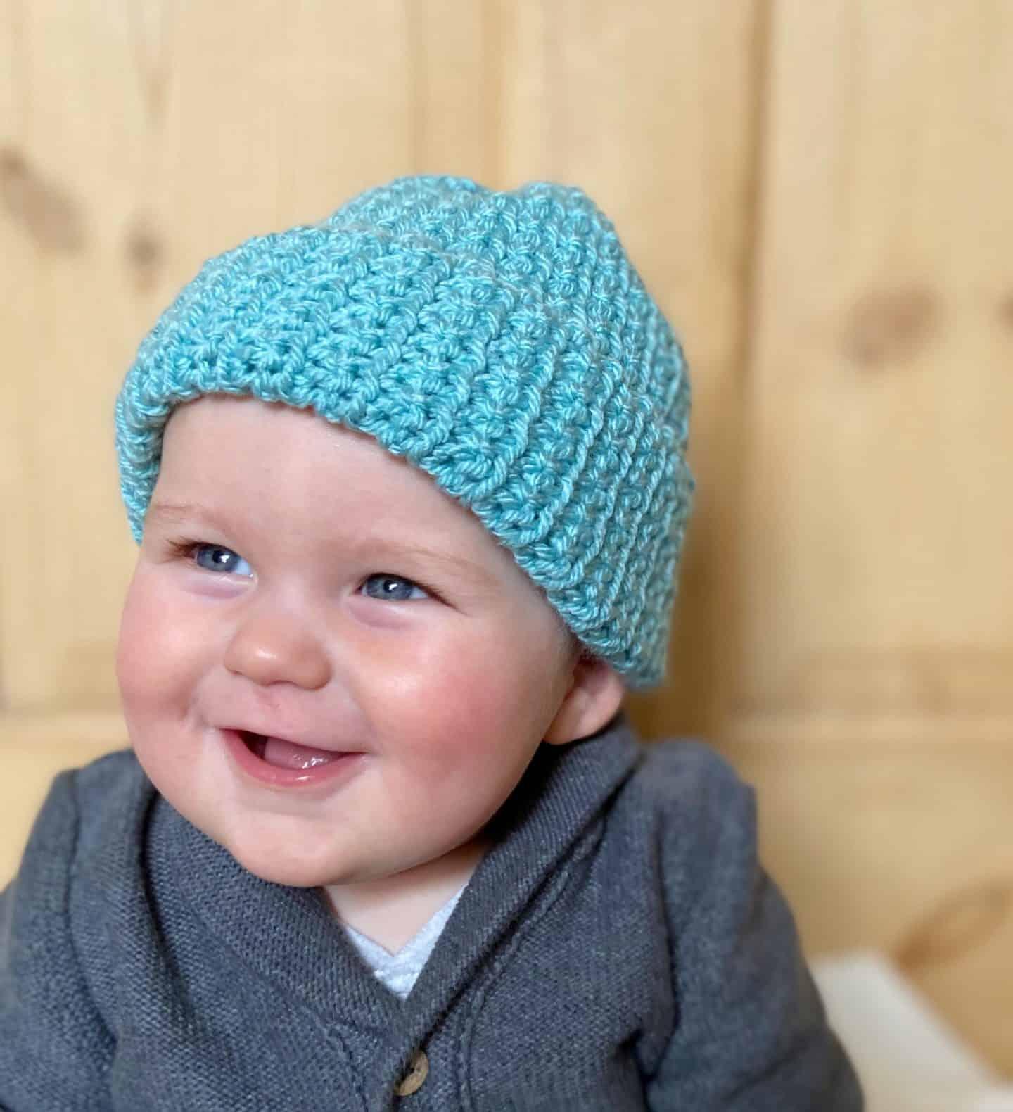 smiling baby boy in easy crochet beanie hat