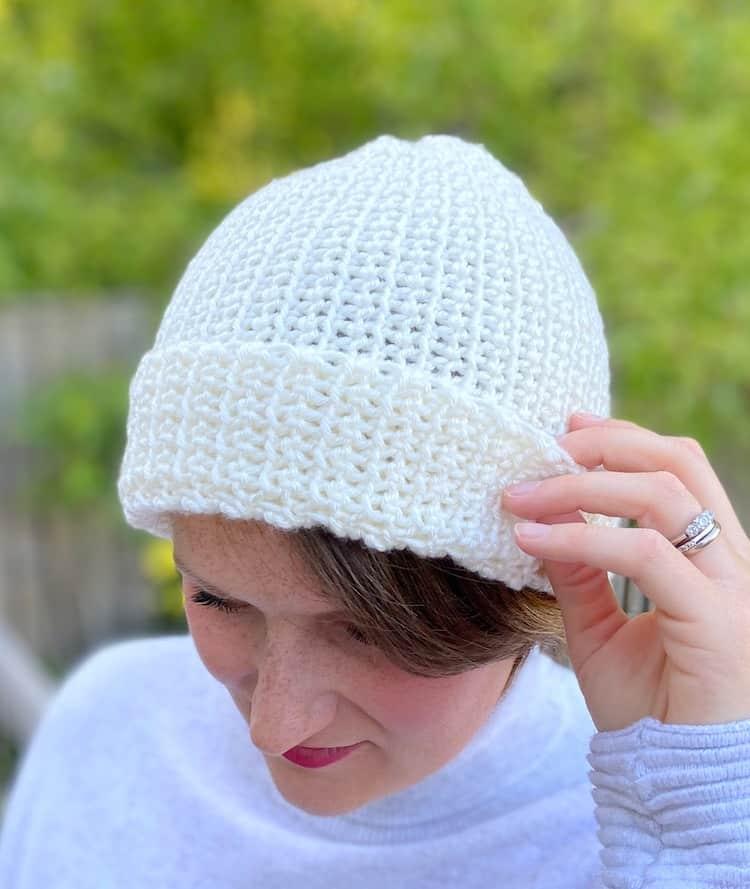 woman wearing cream crochet beanie hat