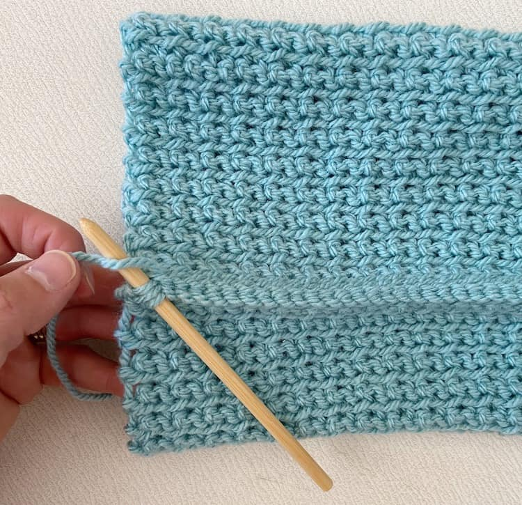 crochet hat being seamed together