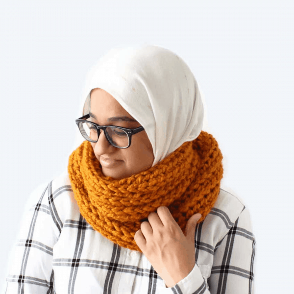 yellow crochet scarf on woman in glasses with headscarf