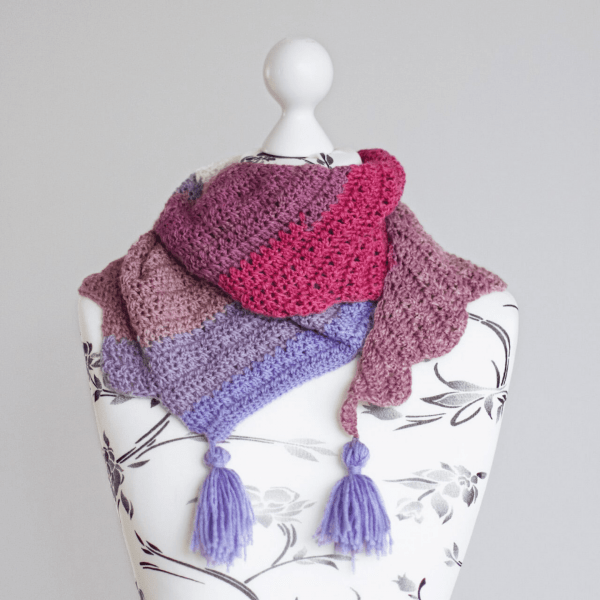 pink and purple crochet scarf with tassels