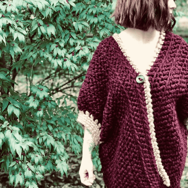 burgundy and cream cardigan on woman in woods