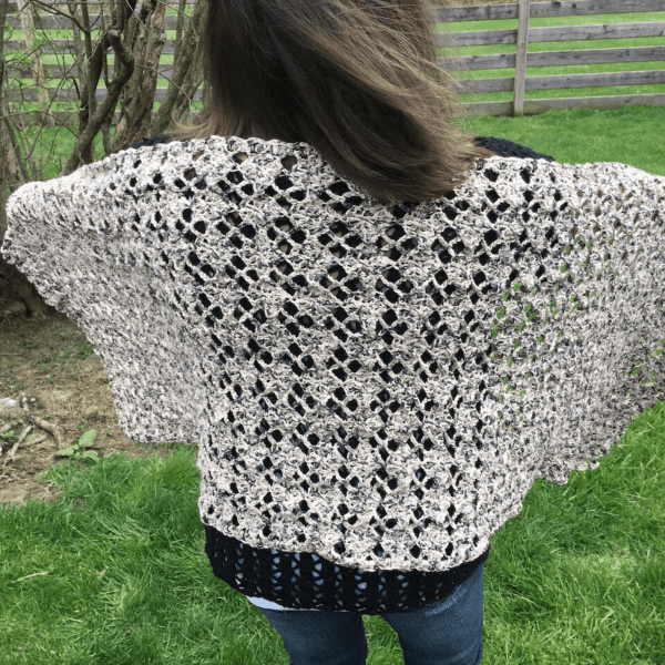 cream lace crochet cardigan on woman facing backwards