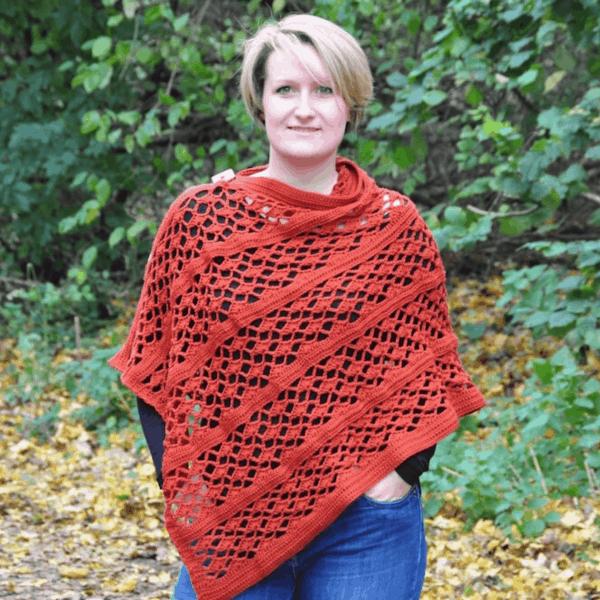 woman in woods wearing crochet orange poncho