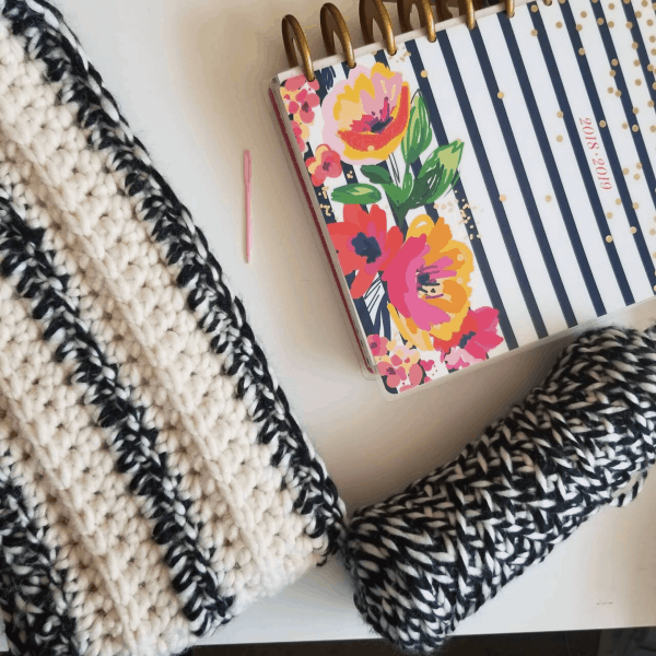 black and white headband with notebook