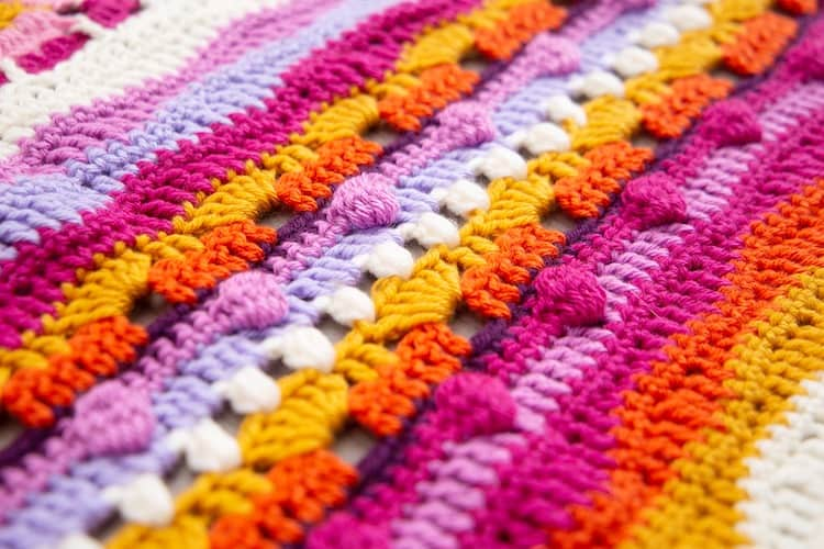 crochet bobble stitch close up in orange, pink and yellow