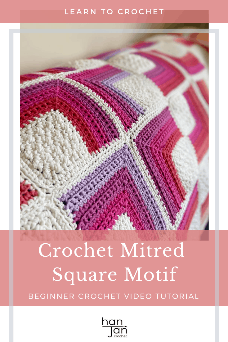 pink, purple, red and white crochet blanket on sofa