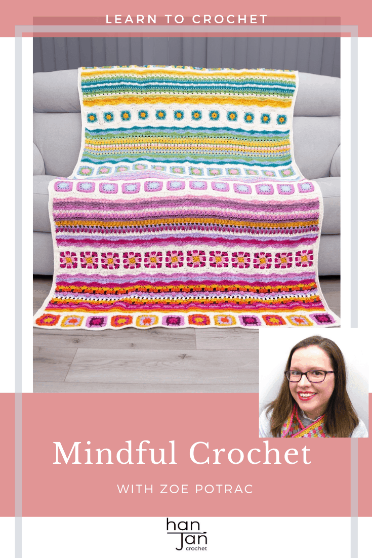 mindfulness crochet blanket on grey sofa in bright and cheery colours