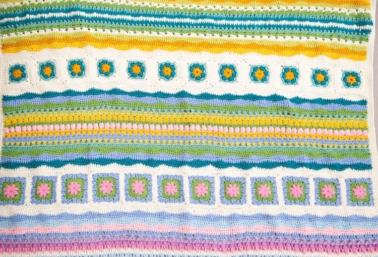 crochet blanket close up using granny squares and crochet wave stitch