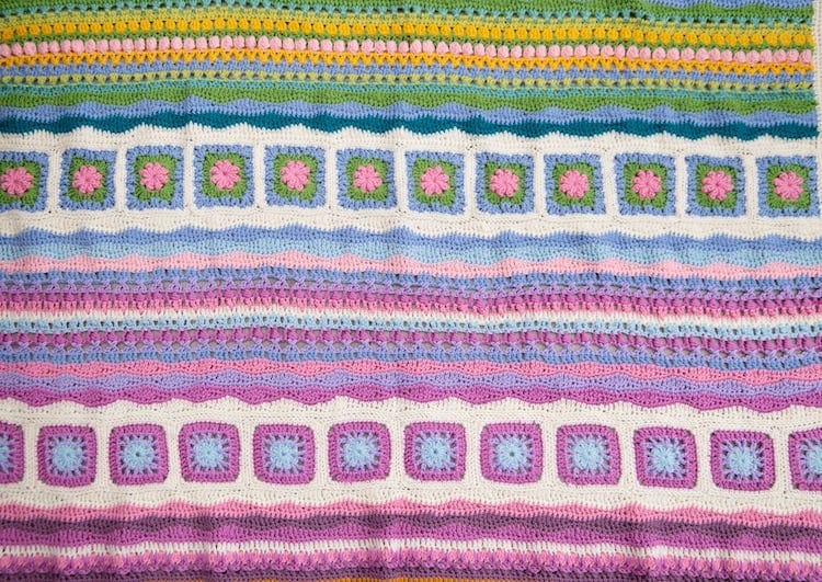 mindfulness crochet blanket, close up of pink, yellow, blue and green crochet squares and wave stitches