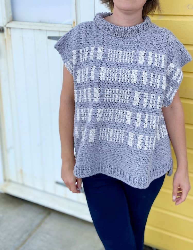 close up of grey and white textured crochet poncho pattern