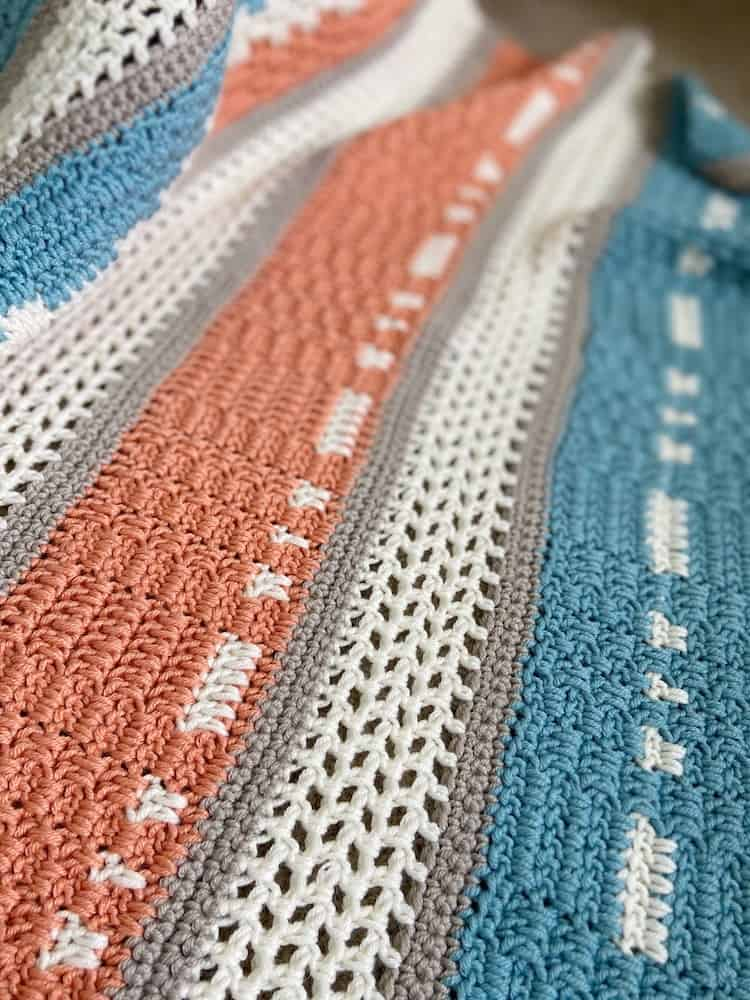 close up of filet and moss stitch in modern crochet blanket for babies