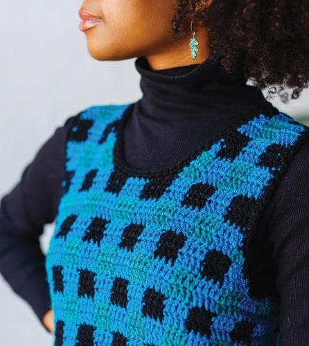 woman wearing blue and black plaid pinafore crochet dress