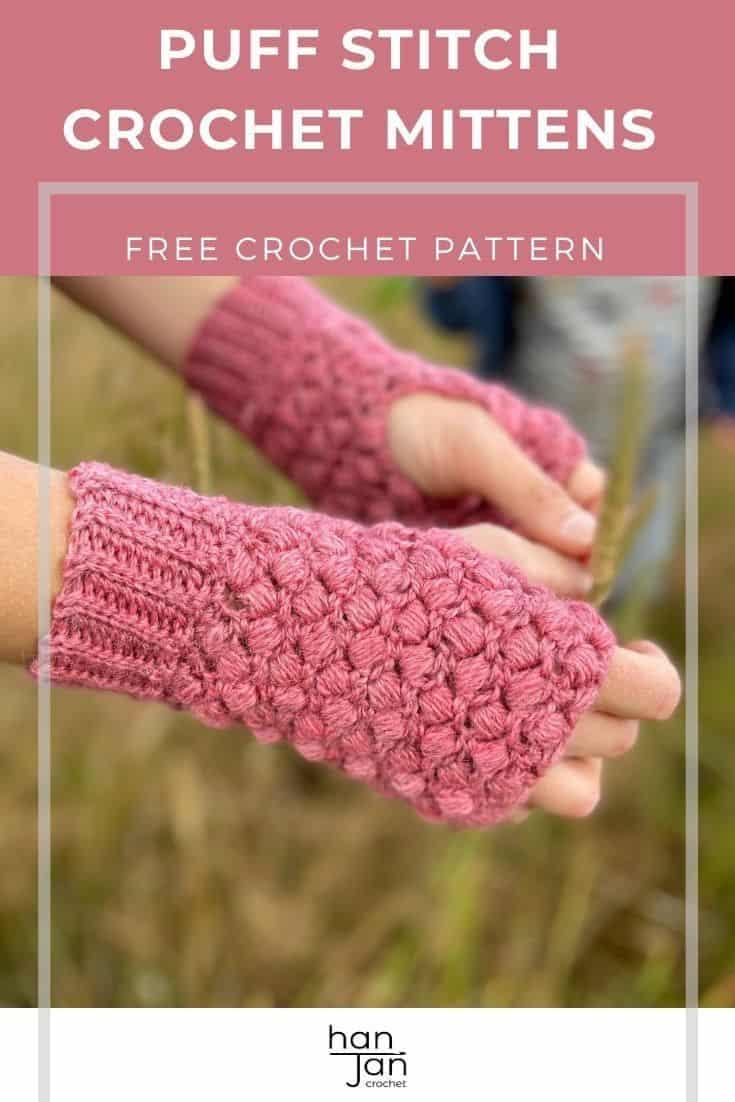 close up of hands wearing pink puff stitch crochet fingerless mittens