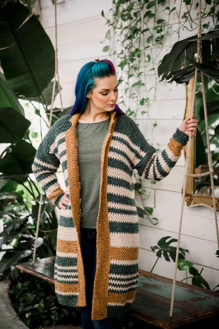 woman with blue hair wearing striped shortbread duster crochet cardigan