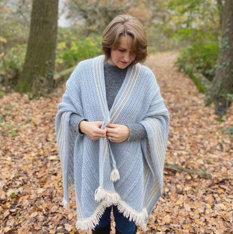 crochet blanket ruana wrap worn by woman in the woods