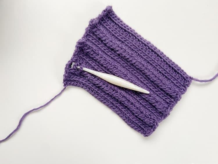 crochet hook an yarn showing crochet braid technique