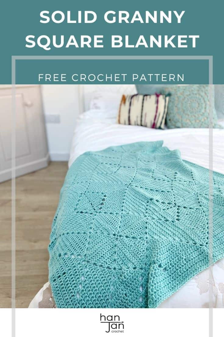 washed teal crochet lace blanket laying on end of bed