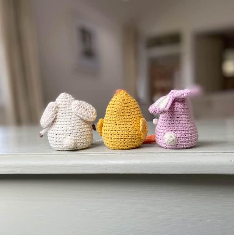 back view of amigurumi crochet toys bunny, chick and lamb