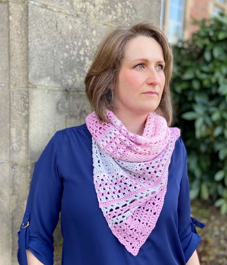 woman wearing pink and grey lace crochet shawl