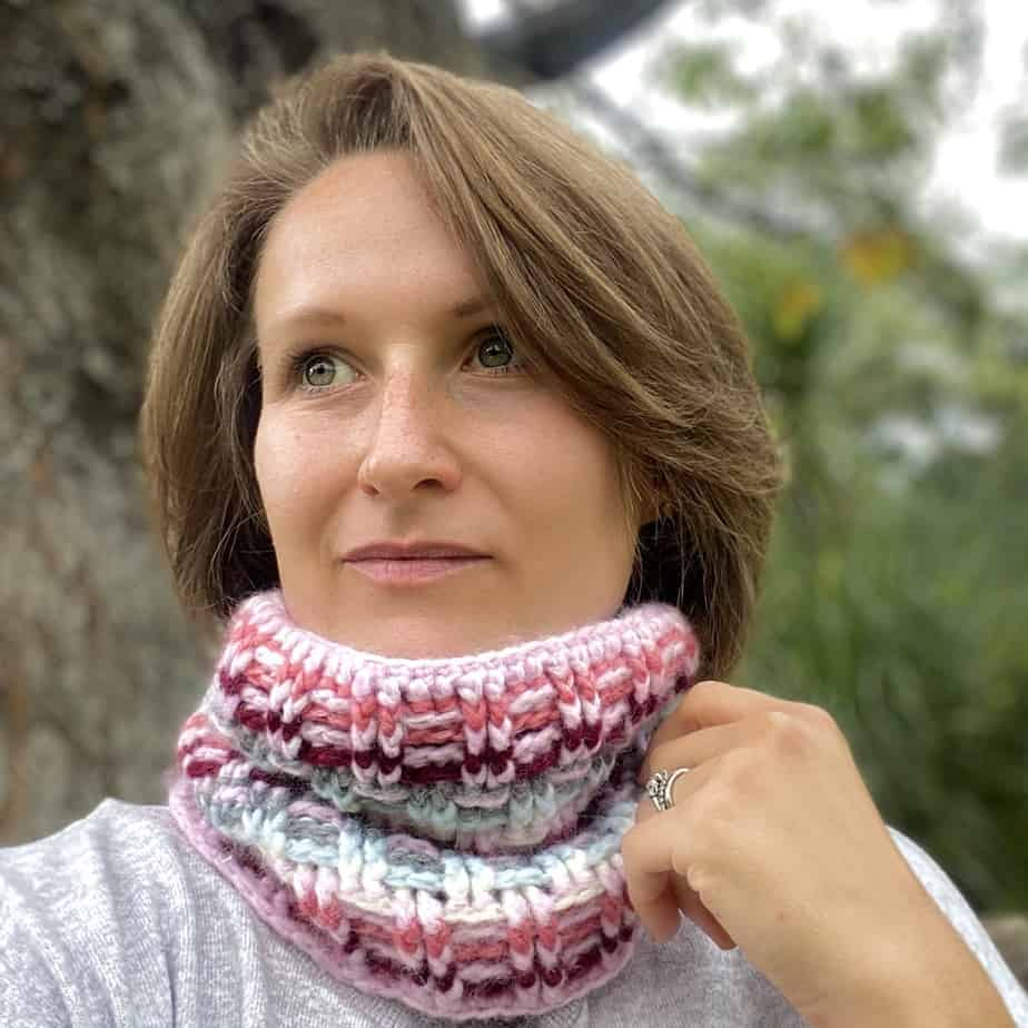 woman wearing rib stitch crochet cowl looking into the distance