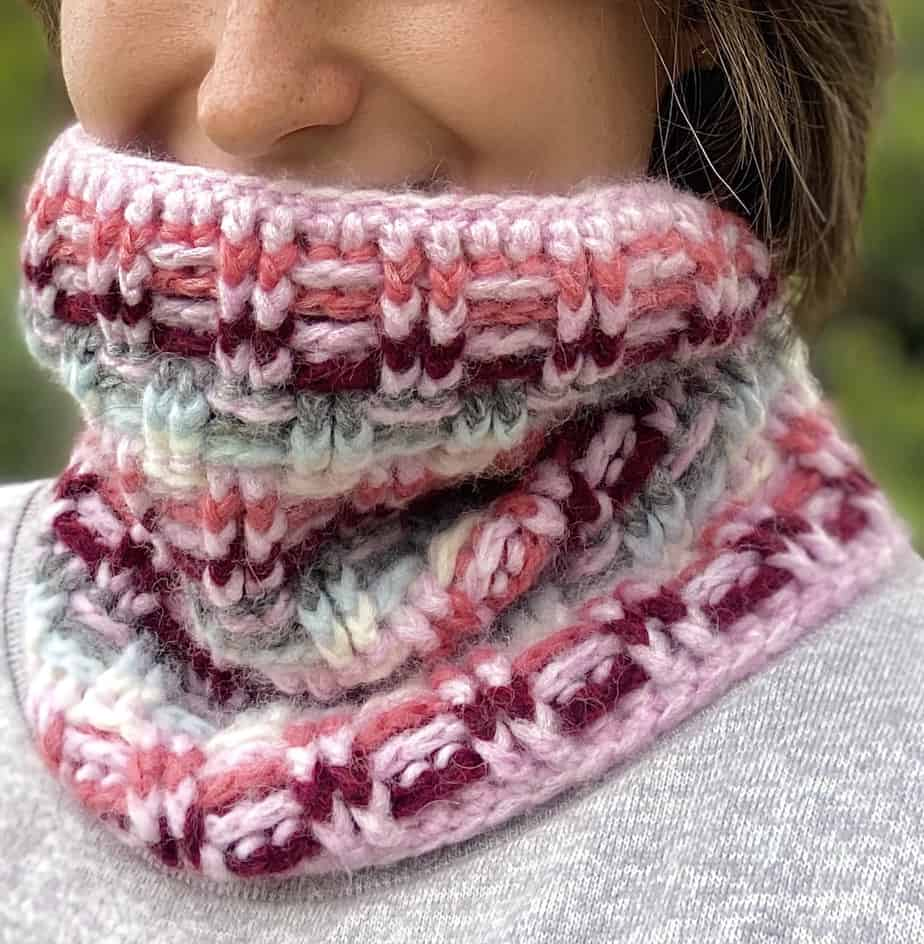 close up of woman wearing cozy winter crochet cowl