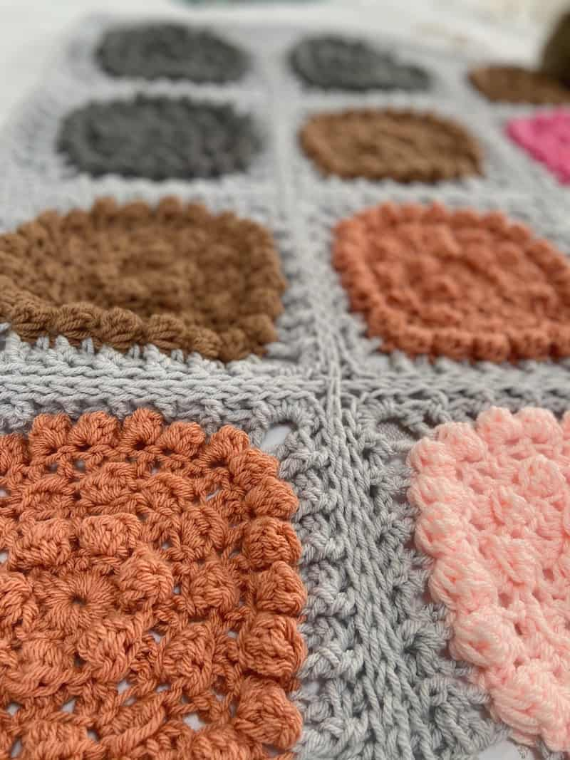 Close up of a chunky crochet blanket with bobble stitches