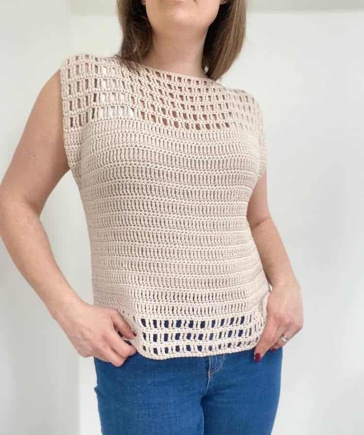 woman wearing lace summer crochet top in cream