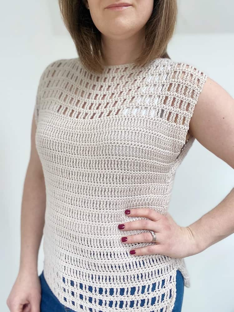 woman with one hand on hip wearing cream easy crochet top pattern