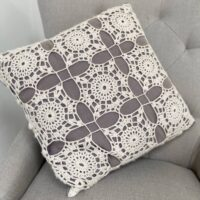 crochet lace square motif cushion in grey and white