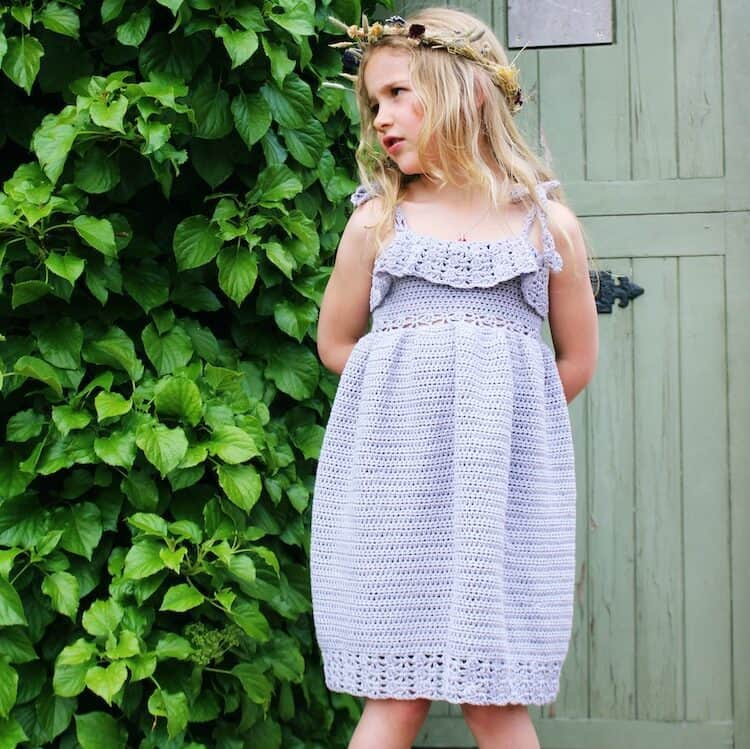 girl wearing lavender lace crochet dress with show string straps