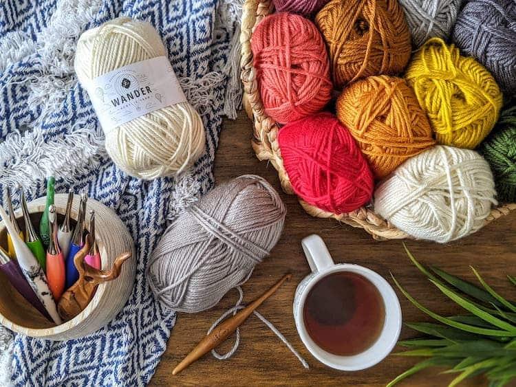 wander yarn by Furls in basket with blanket and crochet hooks