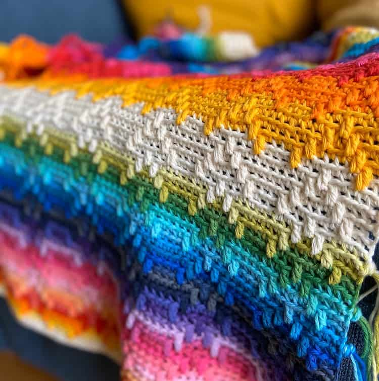 detail of overlay mosaic crochet blanket in rainbow colours