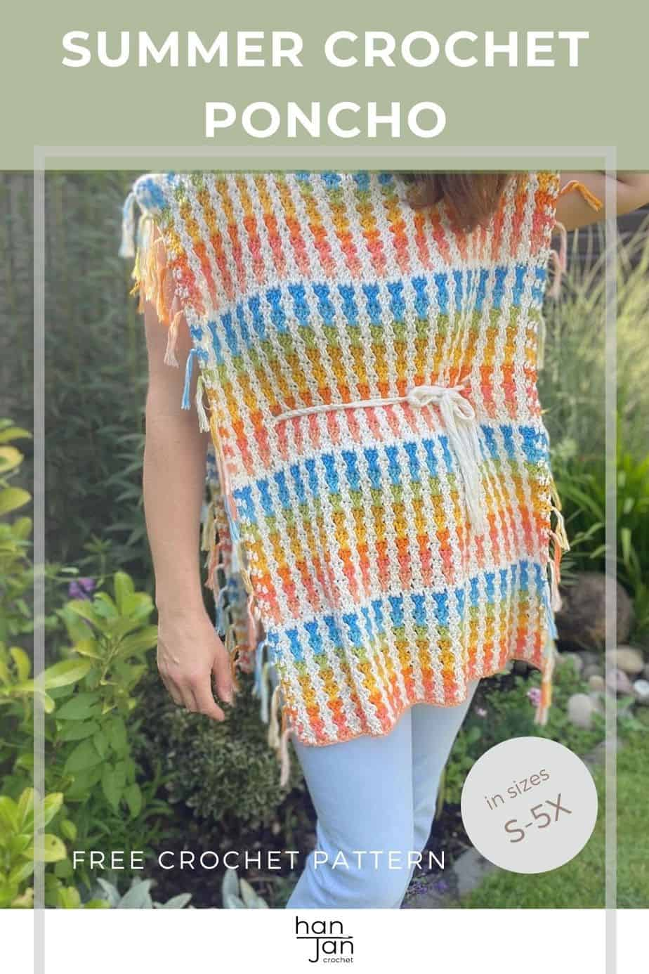 woman wearing pastel coloured crochet poncho and light blue jeans
