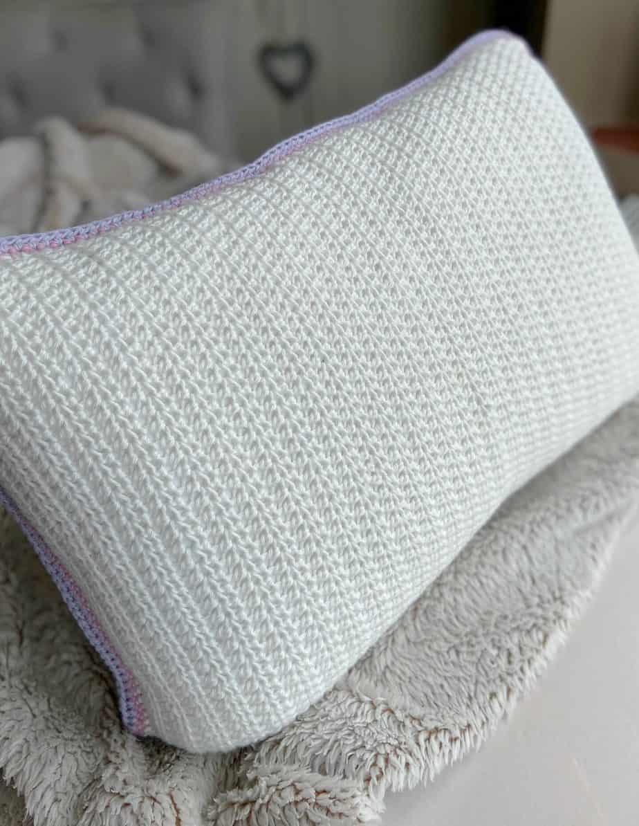 plain crochet back panel in white of floral granny cushion