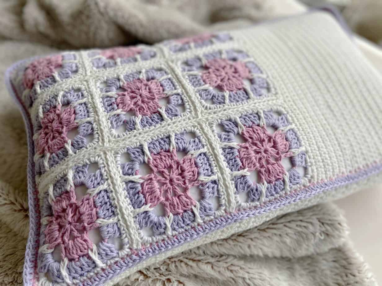 close up of crochet floral granny square motif on cushion