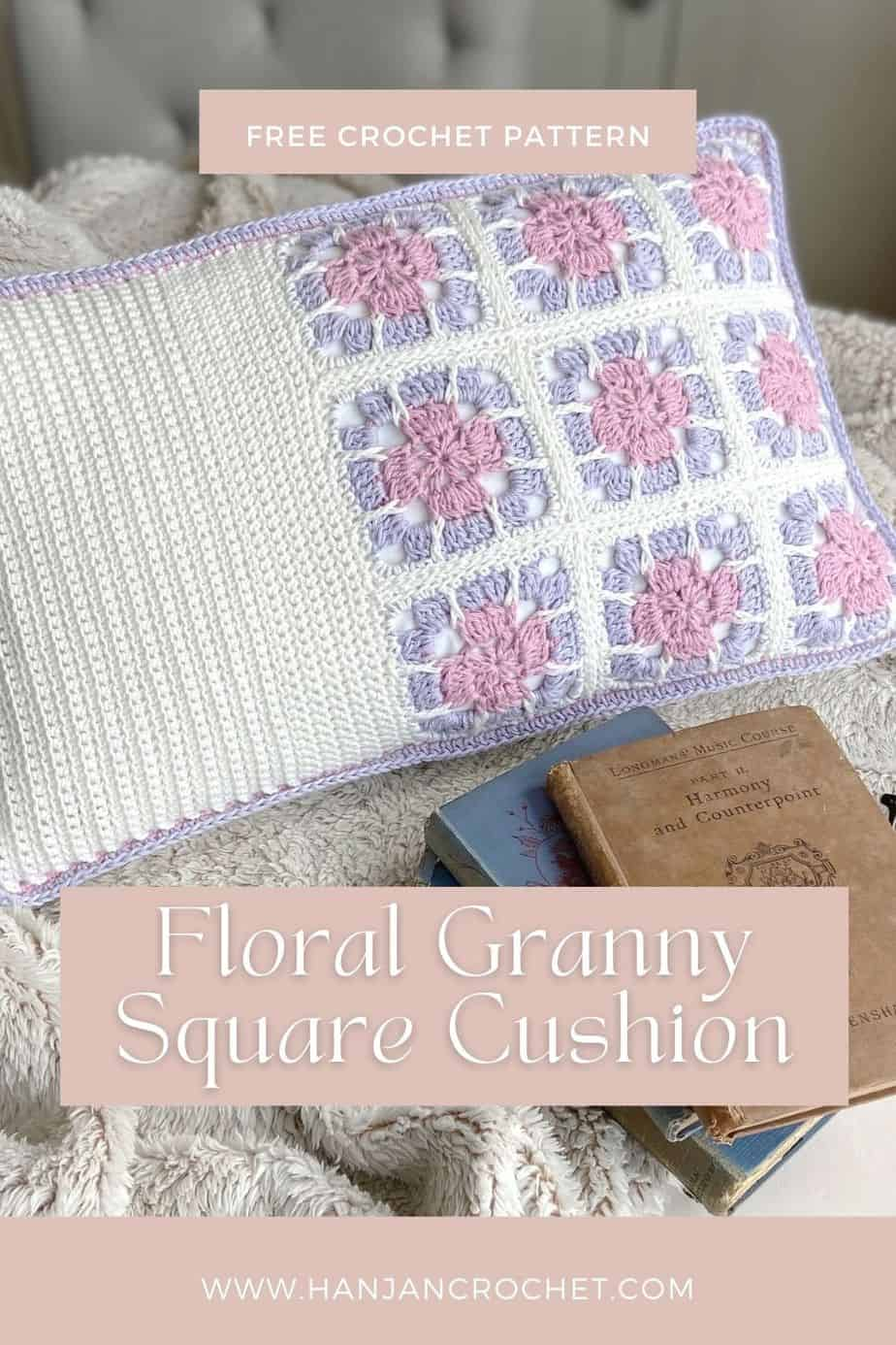 pink, lilac and whit floral granny square pillow with books and fluffy blanket